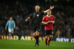 MANCHESTER, ENGLAND - Wednesday, November 10, 2010: Referee Chris Foy during the Premiership match at the City of Manchester Stadium. (Pic by: Chris Brunskill/Propaganda)
