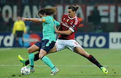 23.11.2011, Giuseppe Meazza Stadion, Mailand, ITA, UEFA CL, Gruppe H, AC Mailand (ITA) vs FC Barcelona (ESP), im Bild Zlatan IBRAHIMOVIC (Milan), Carles PUYOL (Barcellona) // during the football match of UEFA Champions league, group H, between Gruppe H, AC Mailand (ITA) and FC Barcelona (ESP) at Giuseppe Meazza Stadium, Milan, Italy on 2011/11/23. EXPA Pictures © 2011, PhotoCredit: EXPA/ Insidefoto/ Alessandro Sabattini..***** ATTENTION - for AUT, SLO, CRO, SRB, SUI and SWE only *****