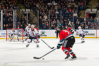 KELOWNA, BC - OCTOBER 12: Dylan Garand #31 defends the net as Zane Franklin #16 of the Kamloops Blazers watches the pass to block a shot by Carson Sass #7 of the Kelowna Rockets at Prospera Place on October 12, 2019 in Kelowna, Canada. (Photo by Marissa Baecker/Shoot the Breeze)