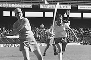 Wexford goalie hitting the slitor out as Cork attempts to block her mid swing during the All Ireland Senior Camogie Final Cork v Wexford in Croke Park on the 21st September 1975. Wexford 4-3 Cork 1-2.