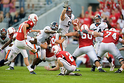 Virginia defensive end Chris Long (91) goes up to try and block a North Carolina State FB Harrison Ritcher (27) field goal attempt.   Long managed to tip a FG later in the game.  The North Carolina State Wolfpack defeated the #15 Virginia Cavaliers 29-24 at Carter Finley Stadium in Raleigh, NC on October 27, 2007.