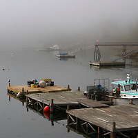 Coastal Maine working harbor photography on a foggy morning in Northeast Harbor, ME. Northeast Harbor is a scenic New England working harbor village filled with lobster boats, dories, and pleasure boat. It is especially photogenic on a fog filled morning. I arrived early to photograph the boats anchored in the Atlantic Ocean before the sun was burning off the fog. <br /> Coastal Maine photos are available as museum quality photography prints, canvas prints, acrylic prints or metal prints. Prints may be framed and matted to the individual liking and room decor needs:<br /> <br /> http://juergen-roth.pixels.com/featured/northeast-harbor-juergen-roth.html<br /> <br /> Good light and happy photo making!<br /> <br /> My best,<br /> <br /> Juergen<br /> Licensing: http://www.rothgalleries.com<br /> Photo Prints: http://juergen-roth.pixels.com<br /> Photo Blog: http://whereintheworldisjuergen.blogspot.com<br /> Instagram: https://www.instagram.com/rothgalleries<br /> Twitter: https://twitter.com/naturefineart<br /> Facebook: https://www.facebook.com/naturefineart