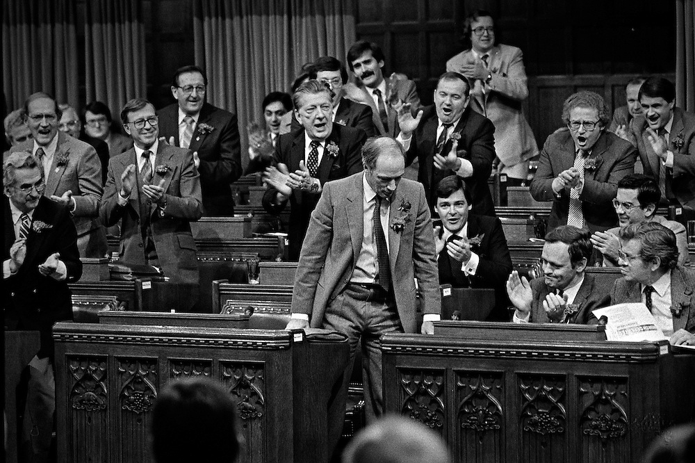 Canadian Prime Minister Pierre Trudeau (C) is cheered by cabinet ministers and MPs as he bows to the Speaker during the historical vote in the House of Commons to repatriate Canada's Constitution held in the British Parliament. (1981)