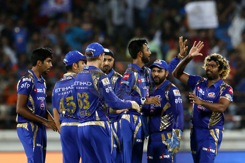 Mumbai Indians players celebrates the wicket of  Dinesh Karthik of the Gujarat Lions during match 35 of the Vivo 2017 Indian Premier League between the Gujarat Lions and the Mumbai Indians  held at the Saurashtra Cricket Association Stadium in Rajkot, India on the 29th April 2017<br /> <br /> Photo by Vipin Pawar - Sportzpics - IPL