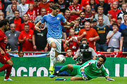 Manchester City defender John Stones (5) clears the ball during the FA Community Shield match between Manchester City and Liverpool at Wembley Stadium, London, England on 4 August 2019.