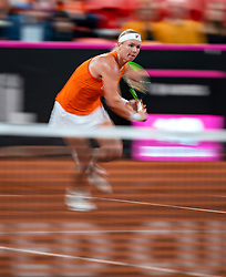 Kiki Bertens in action in the match against Aljaksandra Sasnovich in the Fed Cup qualifier against Belarus in Sportcampus Zuiderpark, The Hague, Netherlands