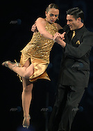 The Argentine couple of Maria Paula Casarotto (L) and Carlos Marcelo Bossi dance during the semifinal round of the Stage Tango competition at the Tango Dance World Championship in Buenos Aires on August 25, 2012.   AFP PHOTO / Alejandro PAGNI