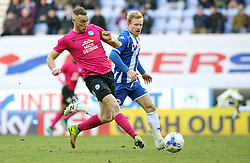 Marcus Maddison of Peterborough United in action with David Perkins of Wigan Athletic - Mandatory byline: Joe Dent/JMP - 05/03/2016 - FOOTBALL - DW Stadium - Wigan, England - Wigan Athletic v Peterborough United - Sky Bet League One