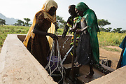 Girls get water from a UNICEF-sponsored, pedal-activated pump in the village of Game, Guera province, Chad on Tuesday October 16, 2012.