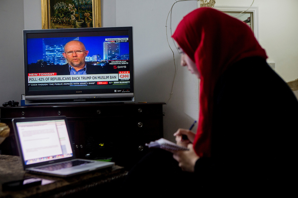 BRONX, NY - DECEMBER 10, 2015: Hebh Jamal, a 15-year-old Muslim, does homework at her family's home in the Bronx while watching coverage on CNN of presidential candidate Donald J. Trump's plan to temporarily halt Muslims from being allowed into the United States. CREDIT: Sam Hodgson for The New York Times.