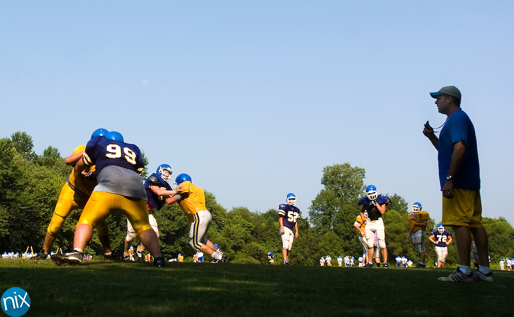 Mount Pleasant head coach Mike Johns watches his players run through drills Monday, Aug. 10.