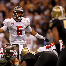January 2, 2011; New Orleans, LA, USA; Tampa Bay Buccaneers quarterback Josh Freeman (5) against the New Orleans Saints during the third quarter at the Louisiana Superdome. Mandatory Credit: Derick E. Hingle