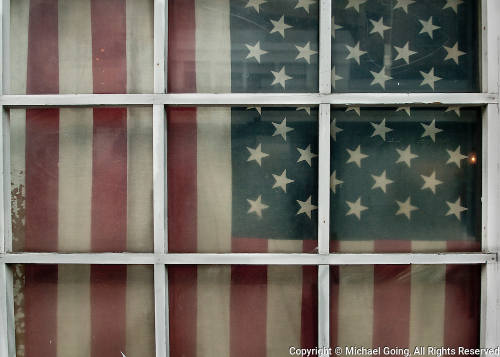 Faded American Flag in window