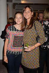 Left to right, JULIE CLAPTON and her mother MELIA CLAPTON at a reception to celebrate the publication of Hockney - A Pilgrim's Progress by Christopher Simon Sykes held at Sotheby's, New Bond Street, London on 30th September 2014.