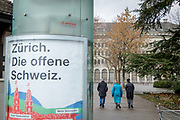 """The Swiss Federal Bank in Zurich. In the foreground; a poster that says """" Zurich, the open Switzerland""""Zurich is by far the biggest city in Switzerland, with a population near 1.83 million in the metropolitan area. It is also the finacial center in Switzerland."""