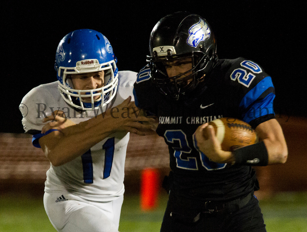 Summit Christian Academy running back Josh McConnell tries to fend off Holden's Karsen Kauffman on Friday. McConnell picked up 63 yards rushing on 20 carries as SCA's season ended with a 14-3 home loss.
