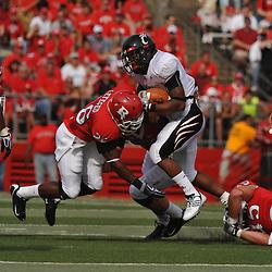 Sep 7, 2009; Piscataway, NJ, USA; Rutgers cornerback Joe Lefeged (26) tackles Cincinnati running back Isaiah Pead (23) during the first half of Rutgers game against Cincinnati in NCAA college football at Rutgers Stadium.