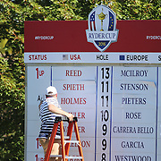 Ryder Cup 2016. Day Three. A scoreboard operator updates information during the Sunday singles competition at  the Ryder Cup tournament at Hazeltine National Golf Club on October 02, 2016 in Chaska, Minnesota.  (Photo by Tim Clayton/Corbis via Getty Images)