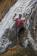 Indonesia, Lombok archipelago, Moyo island, rain forest, people in waterfall