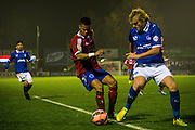 Jaydon Gibbs and Jack Whatmough during the The FA Cup match between Aldershot Town and Portsmouth at the EBB Stadium, Aldershot, England on 19 November 2014.