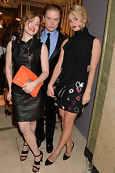 Left to right, HOLIDAY GRAINGER, FREDDIE FOX and LILY JAMES at a Dinner to celebrate the launch of the Mulberry Cara Delevingne Collection held at Claridge's, Brook Street, London on 16th February 2014.