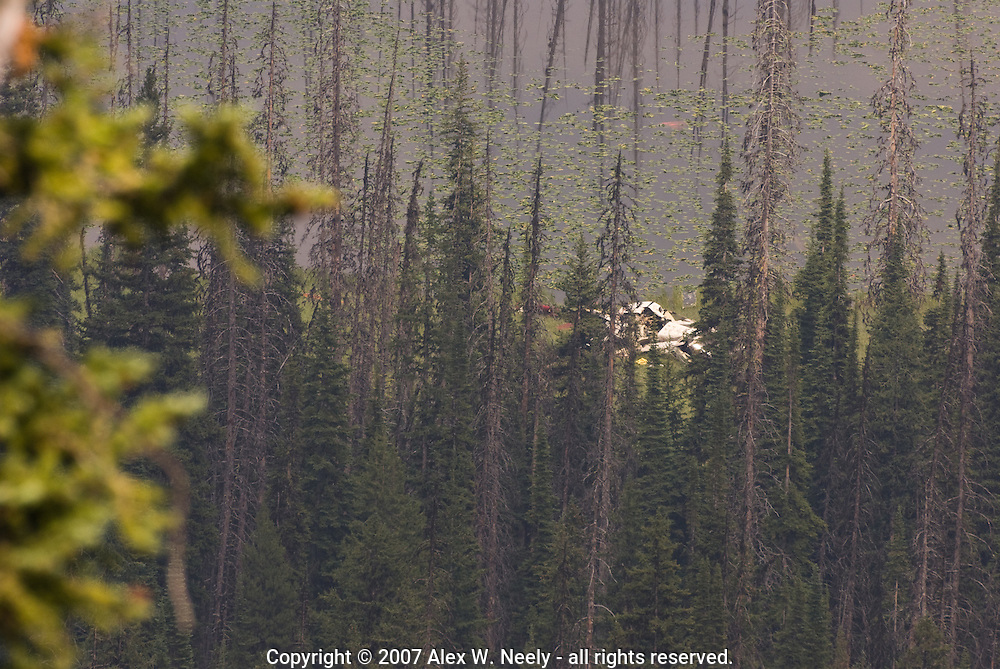 This Bell 214ST helicopter working under contract on the Loon Lake fire in the Payette National Forest in central Idaho made an emergency landing on the edge of Steamboat Lake in a remote and rugged area of the forest.  Both the pilot and mechanic sustained non-life threatening injuries and were airlifted to McCall, ID.  More information is available at http://www.inciweb.org/incident/news/article/801/4542/