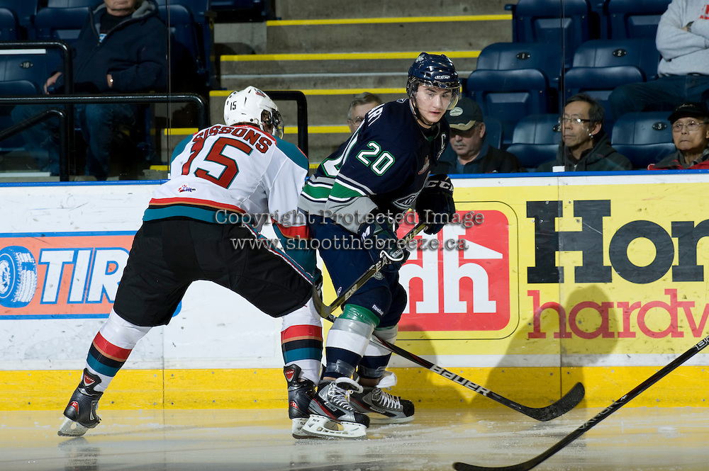 KELOWNA, CANADA, JANUARY 27: Colton Sissons #15 of the Kelowna Rockets checks Luke Lockhart #20 of the Seattle Thunderbirds as the Seattle Thunderbirds visit the Kelowna Rockets on January 27, 2012 at Prospera Place in Kelowna, British Columbia, Canada (Photo by Marissa Baecker) *** Local Caption ***