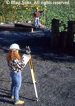 Female surveyor at work