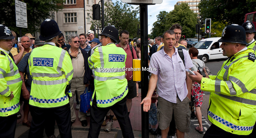 When they hear that the ground is full, police stop the public queueing to get to see the last day of the first npower Test Match between England and India at Lord's Cricket Ground, London.  Photo: Graham Morris (Tel: +44(0)20 8969 4192 Email: sales@cricketpix.com) 25/07/11