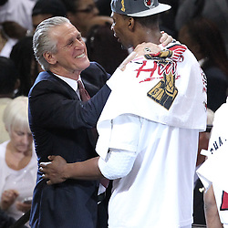 Jun 21, 2012; Miami, FL, USA; Pat Riley hugs Miami Heat power forward Chris Bosh (1) after winning the 2012 NBA championship at the American Airlines Arena. Miami won 121-106. Mandatory Credit: Derick E. Hingle-US PRESSWIRE