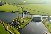 Nederland, Groningen, Gemeente Zuidhoorn, 08-09-2009; Lammerburen, gemaal De Waterwolf aan het Reitdiep; het gehucht is beter bekend onder de naam Electra. Het gemaal, in beheer bij waterschap Noorderzijlvest, zorgt voor de afvoer van water naar het Lauwersmeer.<br /> Lammerburen with pumping station the Water Wolf at the Reitdiep, the hamlet is better known as Electra.<br /> luchtfoto (toeslag op standaard tarieven);<br /> aerial photo (additional fee required);<br /> copyright &copy; foto/photo Siebe Swart
