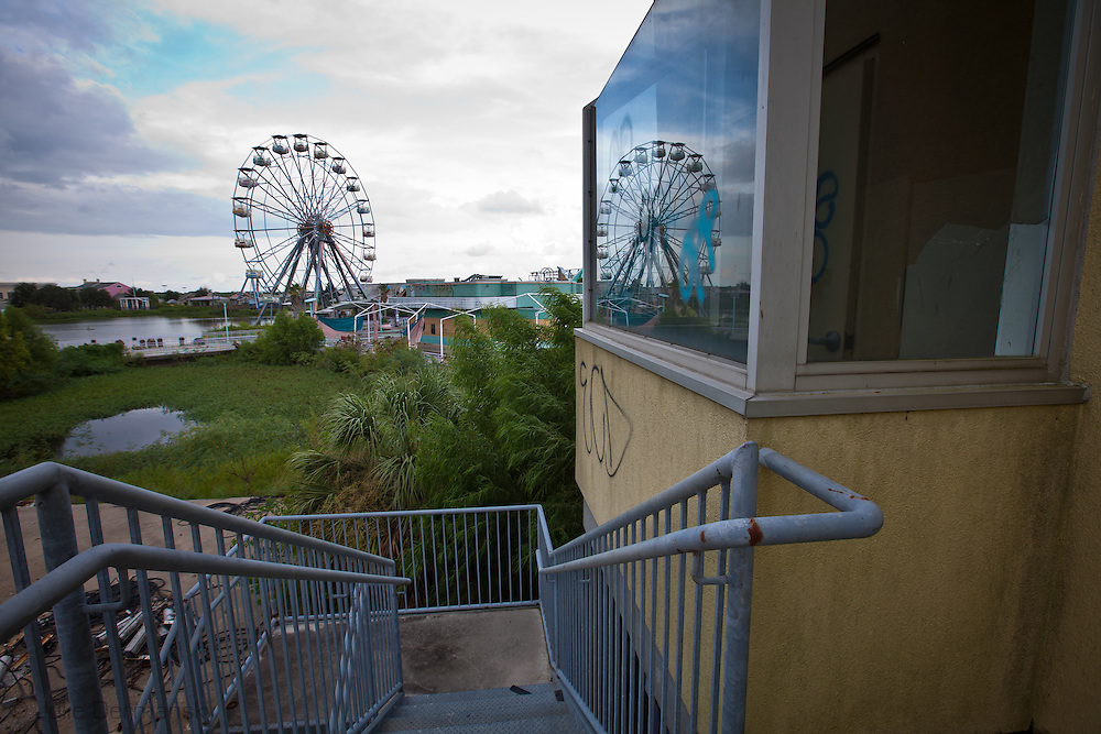 Broken ferris wheel at Six Flags New Orleans amusement park. Six Flags New Orleans amusement park in Eastern New Orleans, Louisiana, closed since Hurricane Katrina  in 2005 remains in a sate of ruin. The remains of Six Flags amusement park are on low lying land owned by the city of New Orleans and have not be redeveloped since Katrina.