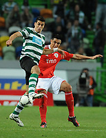 20120409: LISBON, PORTUGAL -Portuguese Liga Zon Sagres 2011/2012 - Sporting CP vs SL Benfica.<br /> In picture: Sporting's Xandão, from Brazil, left, fights for the ball with Benfica's Oscar Cardozo, from Paraguay.<br /> PHOTO: Alvaro Isidoro/CITYFILES
