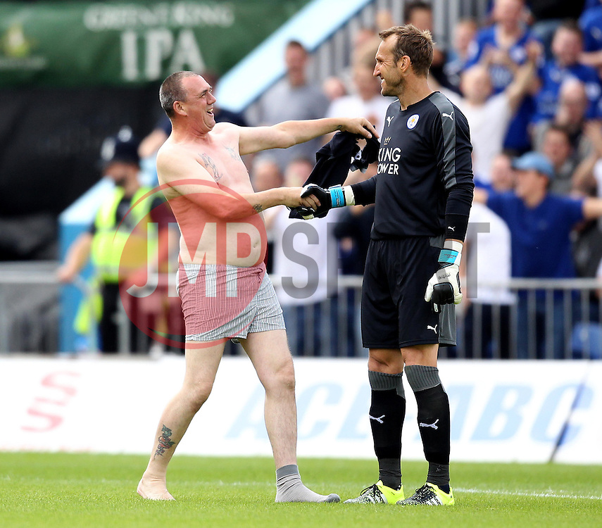 A Leicester City fan invades the pitch and shakes Leicester City's Mark Schwarzer hand - Mandatory by-line: Robbie Stephenson/JMP - 25/07/2015 - SPORT - FOOTBALL - Mansfield,England - Field Mill - Mansfield Town v Leicester City - Pre-Season Friendly
