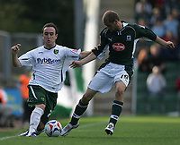 Photo: Lee Earle.<br /> Plymouth Argyle v Norwich City. Coca Cola Championship. 23/09/2006. Norwich's Lee Croft (L) battles with Marcel Seip.