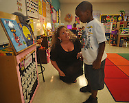 Teacher Mandy James (left) with student London Love on the first day of school at Bramlett Elementary in Oxford, Miss. on Thursday, August 4, 2011.