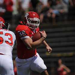 Apr 18, 2009; Piscataway, NJ, USA; Rutgers RB Joe Martinek (38) runs past LB Jim Dumont (53) during the first half of Rutgers' Scarlet and White spring football scrimmage.