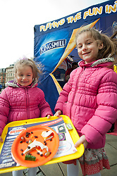 The Kingsmill Big Lunch Tour reaches Sheffield and puts the fun back into lunchtimes as Anca(7) & Dianna (4) Nicula proudly display their sandwich making skills in Fargate Sheffield on Wednesday...http://www.pauldaviddrabble.co.uk.11 April 2012 .Image © Paul David Drabble
