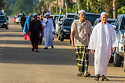 28 JULY 2014 - KHLONG HAE, SONGKHLA, THAILAND: Men walk into Eid al-Fitr services at Songkhla Central Mosque in Songkhla province of Thailand. Eid al-Fitr is also called Feast of Breaking the Fast, the Sugar Feast, Bayram (Bajram), the Sweet Festival and the Lesser Eid, is an important Muslim holiday that marks the end of Ramadan, the Islamic holy month of fasting.   PHOTO BY JACK KURTZ