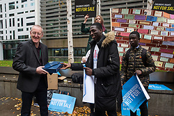 London, UK. 25 November, 2019. Samson Adeola and Daniel, former clients of the Project for the Registration of Children as British Citizens (PRCBC), join campaigners from Amnesty International UK's Children's Human Rights Network and PRCBC outside the Home Office to hand in a letter calling on the British Government to stop selling children's rights. Currently, the Home Office charges £1,012 for citizenship applications, including for children living in poverty or local authority care, whilst the cost of processing an application is £372. Thousands of children with rights to British citizenship are prevented from claiming their rights due to excessive fees.