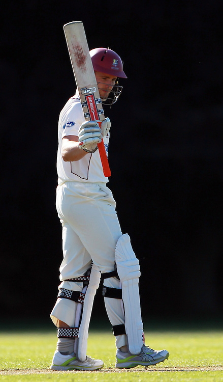 Northern player Kane Williamson raises his bat for 50 runs. Wellington Firebirds v Northern Knights, 4 Day Plunket Shield cricket match, Lincoln Number 3, Monday 14 November 2011. Photo : Joseph Johnson / photosport.co.nz