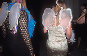 Two girls in fancy dress, wearing angel wings, UK 2004