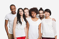 Portrait of young multi-ethnic friends smiling together over white background