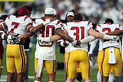 The USC Trojans give a group hug as they get fired up for the 2017 NCAA Rose Bowl college football game against the Penn State Nittany Lions, Monday, Jan. 2, 2017 in Pasadena, Calif. The Trojans won the game 52-49. (©Paul Anthony Spinelli)