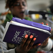 Nekita Waller holds her notebook of lyrics as she rehearses for an upcoming show.