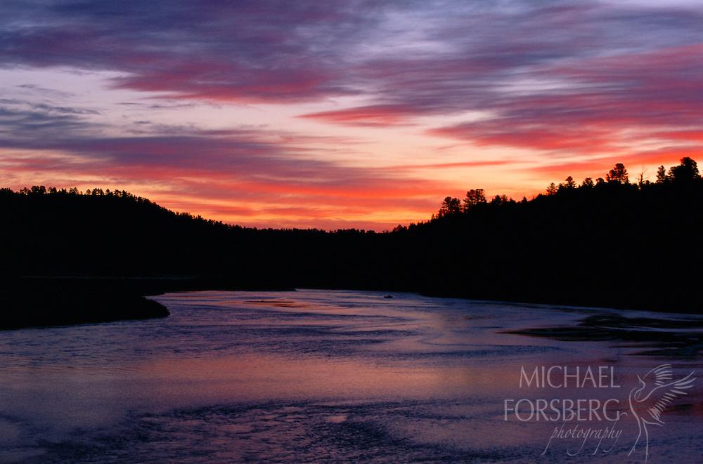 An intense sunset reflects off the river.  Niobrara Valley Preserve, Nebraska