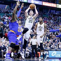 09 December 2015: Utah Jazz forward Gordon Hayward (20) goes for the jump shot over New York Knicks center Kevin Seraphin (1) during the Utah Jazz 106-85 victory over the New York Knicks, at the Vivint Smart Home Arena, Salt Lake City, Utah, USA.