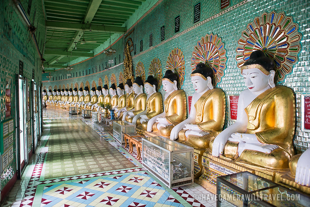 Standing high on a hill in Sagaing, the OoHminThoneSel (Oo Hmin Thone Sel Pagoda) Pagoda features a long, curved alcove lined with dozens of statues of the Buddha. After recent ongoing renovations and upgrades made possible by donors, the pagoda is ornately decorated with colorful tile mosaics and fresh, bright paint.