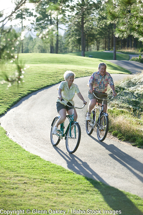 Mature couple enjoys a bike ride on the Boise Green Belt, boise, Idaho