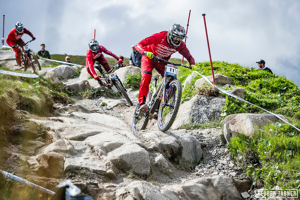 Jack Moir (11), Dean Lucas (89) and Charlie Harrison (28) of Intense Factory Racing during Sunday practise at the UCI Mountain Bike World Cup in Fort William.